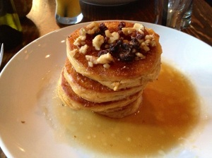 Pumpkin Pancakes with whipped maple butter, syrup, raisins, brown sugar & walnuts